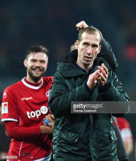Coach Jeff Strasser of Kaiserslautern celebrates after the Second Bundesliga match between SG Dynamo Dresden and 1 FC Kaiserslautern at DDVStadion on...