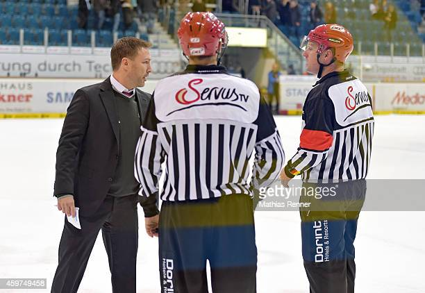 Coach Jeff Tomlinson of the Eisbaeren Berlin speaks with the referees during the game between ERC Ingolstadt and Eisbaeren Berlin on November 30 2014...