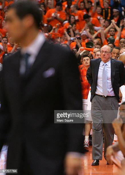 Coach Jim Boeheim of the Syracuse Orange looks on as Coach Jay Wright of the Villanova Wildcats stands in the foreground during the game at the...