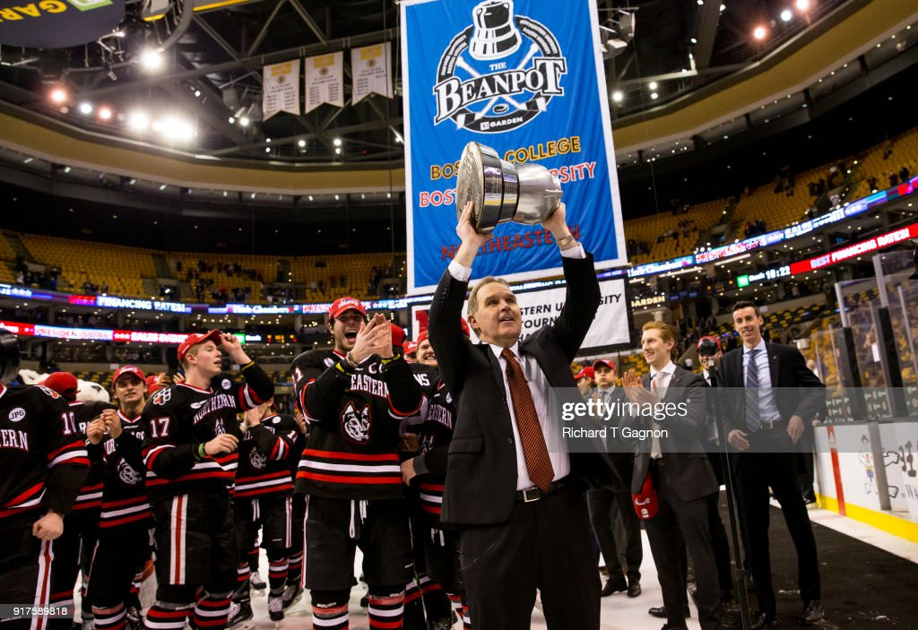 Coach Jim Madigan of the Northeastern Huskies celebrates after a game against the Boston University Terriers during NCAA hockey in the championship game of the annual Beanpot Hockey Tournament at TD Garden on February 12, 2018 in Boston, Massachusetts. The Huskies won 5-2 to capture their first Beanpot in 30 years.