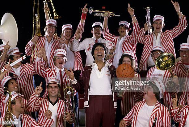Coach Jim Valvano of North Carolina State poses with band members in November 1983 in Raleigh North Carolina