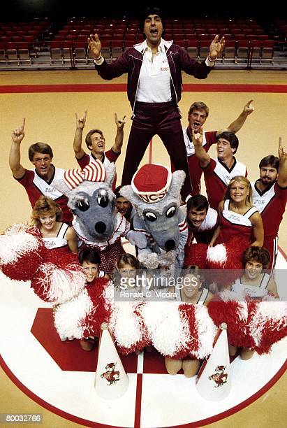 Coach Jim Valvano of North Carolina State poses with cheerleaders in November 1983 in Raleigh North Carolina