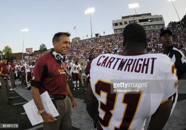 Coach Jim Zorn of the Washington Redskins waits for play against the Indianapolis Colts in the Pro Football Hall of Fame Game at Fawcett Stadium on...
