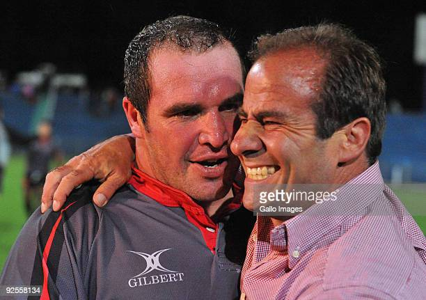 Coach Jimmy Stonehouse of the Pumas with captain Hannes Franklin after their win and promotion to the Currie Cup during the Absa Currie Cup Promotion...