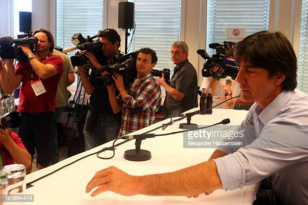 Coach Joachim Loew of Germany arrives for a press conference on the eve of their FIFA World Cup Brazil 2014 qualifier against Austria at...
