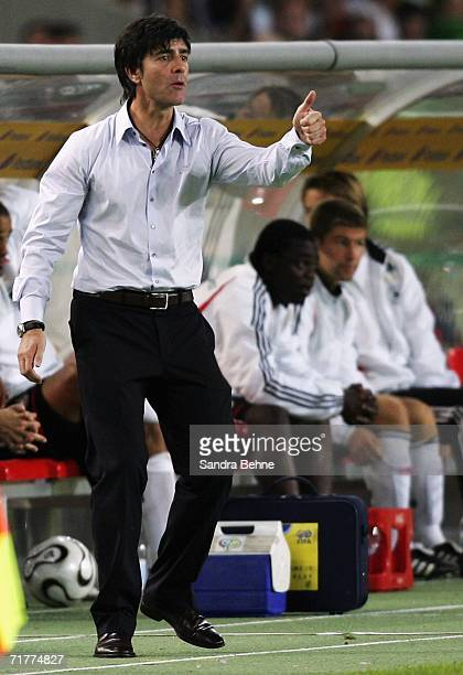 Coach Joachim Loew of Germany gives a thumb up during the Euro 2008 qualifying match between Germany and the Republic of Ireland at the...