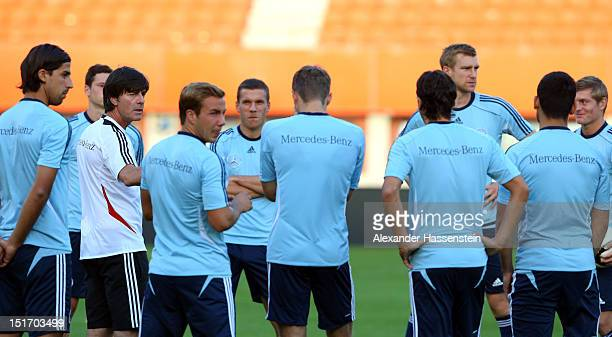 Coach Joachim Loew of Germany talks to his players during a training session, on the eve of their FIFA World Cup Brazil 2014 qualifier against...