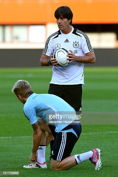 Coach Joachim Loew of Germany talks to Marco Reus during a training session on the eve of their FIFA World Cup Brazil 2014 qualifier against Austria...