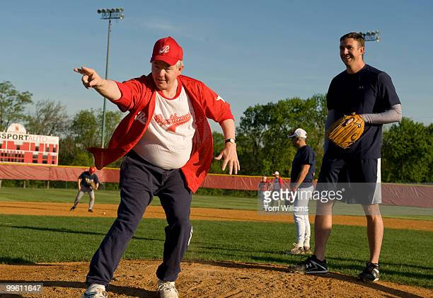 Coach Joe Barton RTexas left instructs freshman pitching candidate Rep Duncan Hunter RCalif during republican baseball practice at Four Mile Run Park...