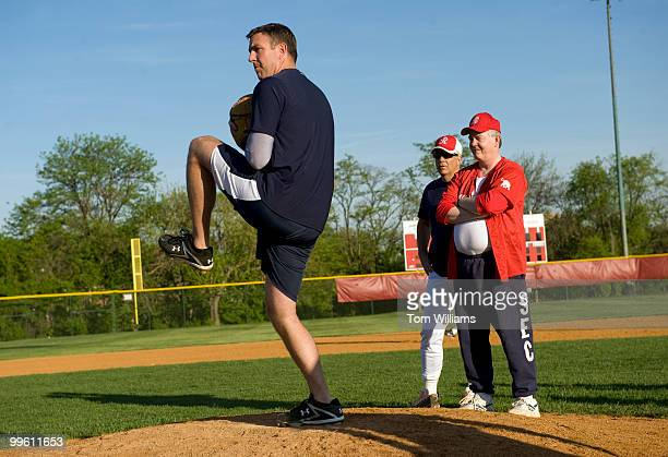 Coach Joe Barton RTexas right and Sen John Ensign RNev oversee freshman pitching candidate Rep Duncan Hunter RCalif during republican baseball...