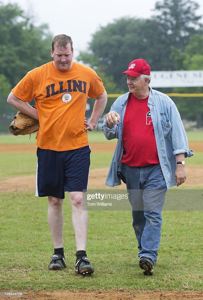 Coach Joe Barton, R-Texas, right, talks with candidate for Congress Jason Plummer, R-Ill., during republican baseball practice at Simpson Stadium in Alexandria, Va.