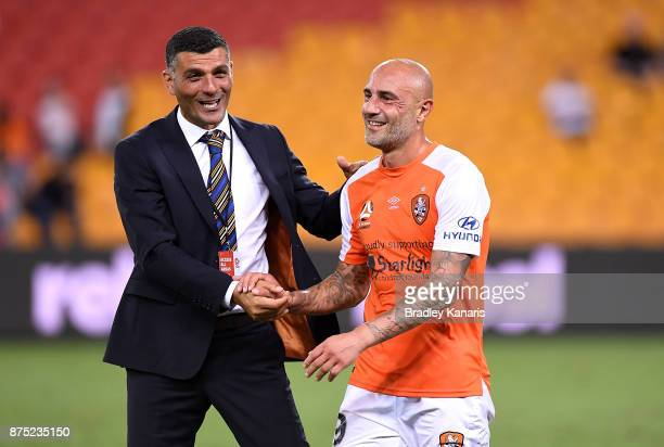 Coach John Aloisi of the Roar celebrates victory with Massimo Maccarone after the round seven ALeague match between Brisbane Roar and Melbourne City...