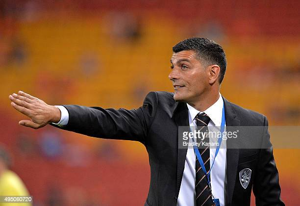 Coach John Aloisi of the Roar gives out instructions to his players from the sideline during the round four ALeague match between Brisbane Roar and...