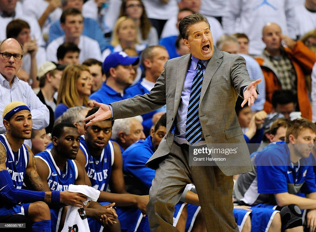 Coach John Calipari of the Kentucky Wildcats complains to the officials during a loss to the North Carolina Tar Heels during play at the Dean Smith Center on December 14, 2013 in Chapel Hill, North Carolina. North Carolina won 82-77.
