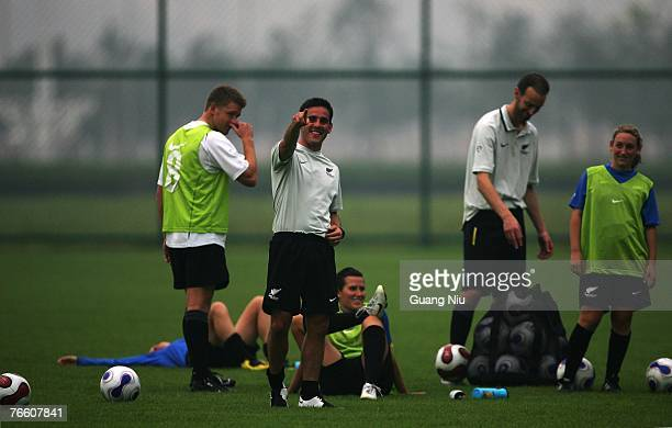 Coach John Herdman of New Zealand ponits journalists after his pants is pulled down by his player at the end of a training session ahead of the FIFA...