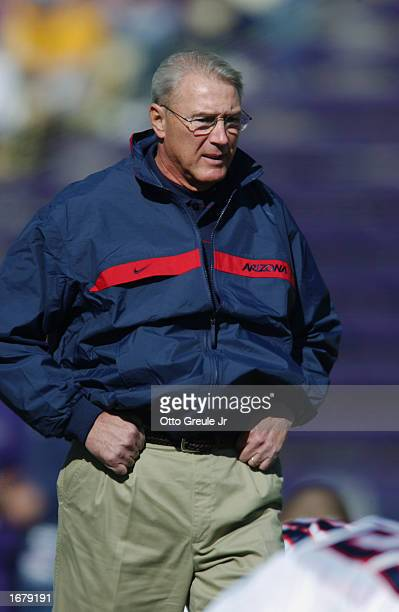 Coach John Mackovic of the Arizona Wildcats focuses on play from the sideline during the NCAA football game against the Washington Huskies at Husky...