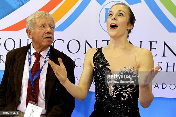 Coach John Nicks and Ashley Wagner react to her score in the Ladies Free Skate during the ISU Four Continents Figure Skating Championships at World...