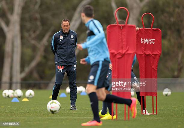 Coach John van't Schip looks on as players complete drills during a Melbourne City ALeague training session at La Trobe University Sports Fields on...