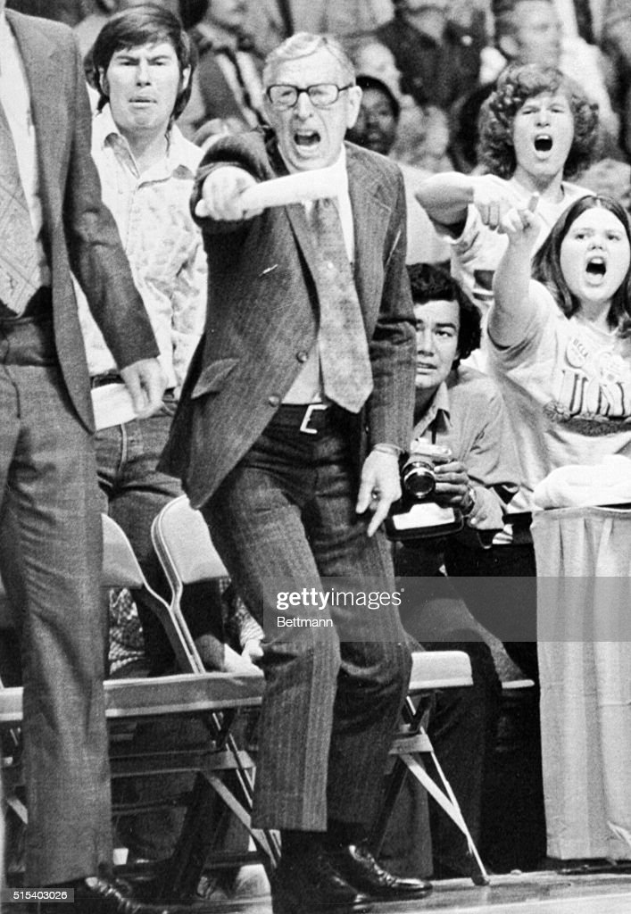 UCLA coach John Wooden, who is referred in basketball circles as the 'Wonder of Westwood', shouts directions to his players from the bench during NCAA championship game here 3/31. Wooden won his last game as UCLA's head coach with a 92-85 victory.