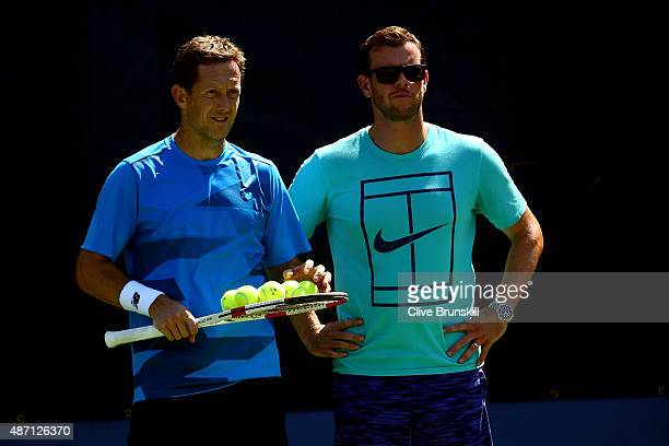 Coach Jonas Bjorkman and Captain of Great Britain Leon Smith look on as Andy Murray of Great Britain practices on Day Seven of the 2015 US Open at...