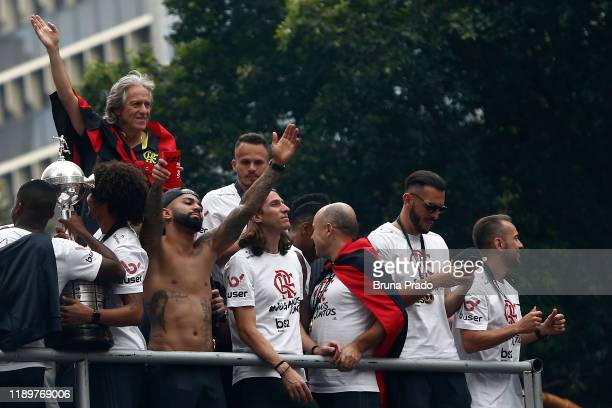 Coach Jorge Jesus and players of Flamengo celebrate on a bus during the champions parade on the day after Flamengo won the Copa CONMEBOL Libertadores...