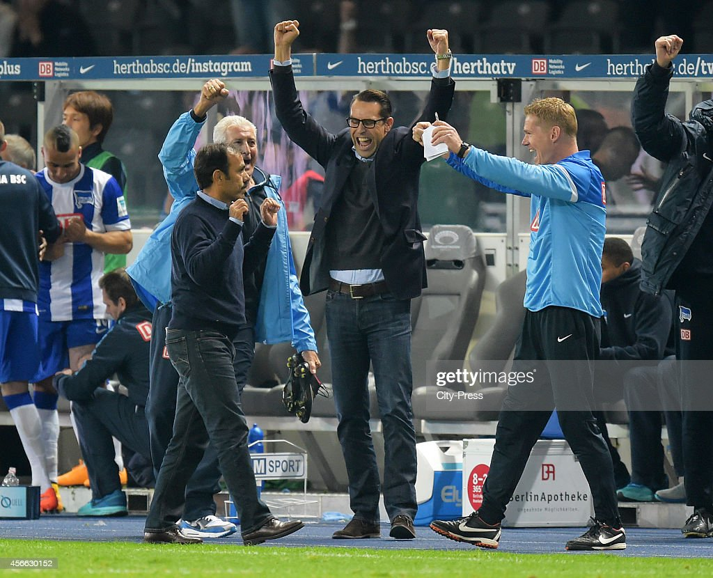 Coach Jos Luhukay, team leader Nello di Martino, CEO Michael Preetz and assistant coach Markus Gellhaus celebrate during the Bundesliga match between Hertha BSC and VfB Stuttgart on October 3, 2014 in Berlin, Germany.