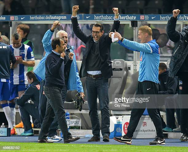 Coach Jos Luhukay team leader Nello di Martino CEO Michael Preetz and assistant coach Markus Gellhaus celebrate during the Bundesliga match between...