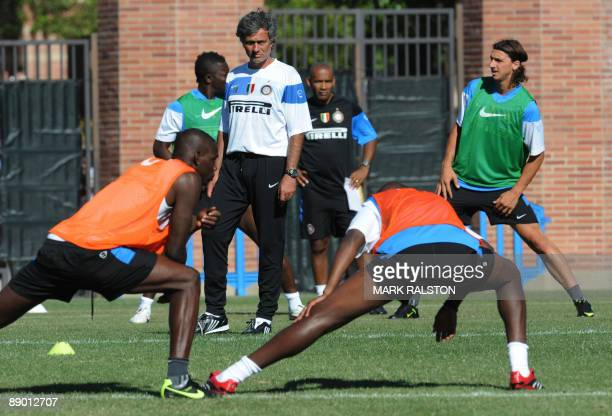 Coach José Mourinho from Inter Milan watches his players and Zlatan Ibrahimovic from Sweden during a training session in Los Angeles on July 13 2009...