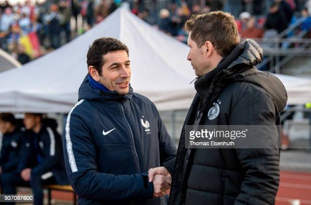 Coach Jose Alcocer of France and german coach Guido Streichsbier shake hands prior the U18 international friendly match between Germany and France at...