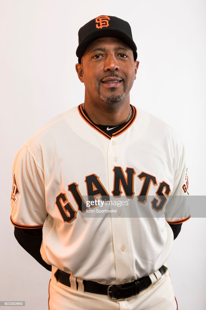 Coach Jose Alguscil (17) poses for a photo during the San Francisco Giants photo day on Tuesday, Feb. 20, 2018 at Scottsdale Stadium in Scottsdale, Ariz.