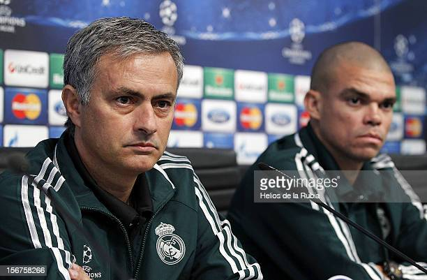 Coach Jose Mourinho and Pepe of Real Madrid attend a press conference ahead of their UEFA Champions League group stage match against Manchester City...