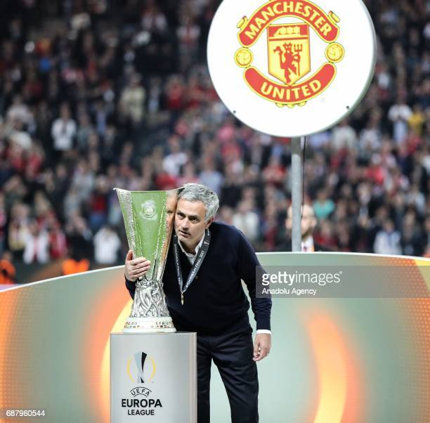 Coach Jose Mourinho of Manchester United is seen near the trophy as he celebrates after the UEFA Europa League Final match between Ajax and...