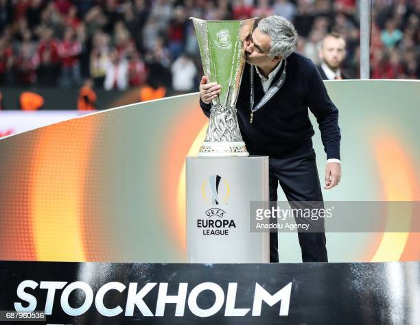 Coach Jose Mourinho of Manchester United kisses the trophy as he celebrates after the UEFA Europa League Final match between Ajax and Manchester...
