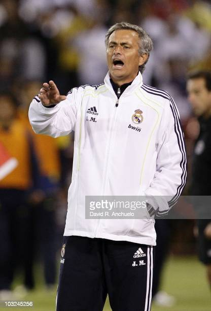 Coach Jose Mourinho of Real Madrid issues instructions during a friendly match between Club America and Real Madrid on August 4, 2010 in San...