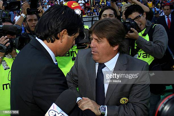 Coach Jose Saturnino Cardozo of Queretaro and coach Miguel Herrera of America during a match between Queretaro v America as part Clausura 2012 at...