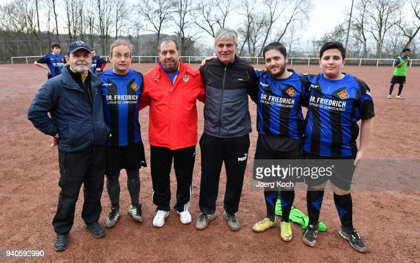 Coach Josef Saxer host Wigald Boning Syrian coach Zaghnoon Jamal and coach Klaus Reinmann are seen on set at 'TuS International Koblenz' during the...