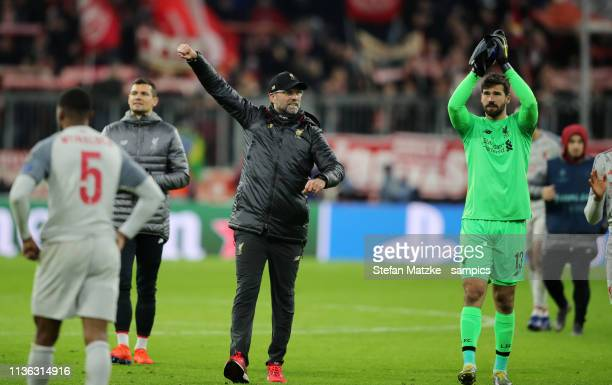 Coach Jürgen Klopp FC Liverpool Alisson FC Liverpool during the UEFA Champions League Round of 16 Second Leg match between FC Bayern Muenchen and...