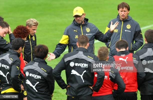 Coach Juergen Klopp of Borussia Dortmund and his players during the training of Borussia Dortmund in Bad Ragaz, Switzerland, 30 July 2014. The...