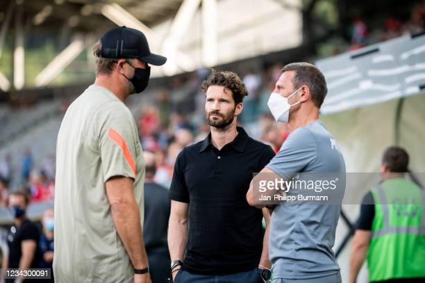Coach Juergen Klopp of FC Liverpool, sports director Arne Friedrich and Marcus 'Max' Jung of Hertha BSC before the friendly match between Hertha BSC...