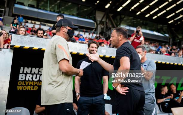 Coach Juergen Klopp of FC Liverpool, sports director Arne Friedrich, coach Pal Dardai of Hertha BSC before the friendly match between Hertha BSC and...