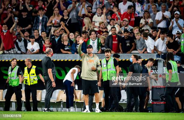 Coach Juergen Klopp of FC Liverpool waves at the fans after the friendly match between Hertha BSC and FC Liverpool at Tivoli Stadion on July 29, 2021...