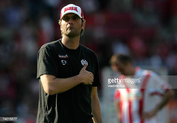 Coach Juergen Klopp of Mainz puts his hand on his heart as he looks at the Mainz fans after losing 1:2 the Bundesliga match between FSV Mainz 05 and...