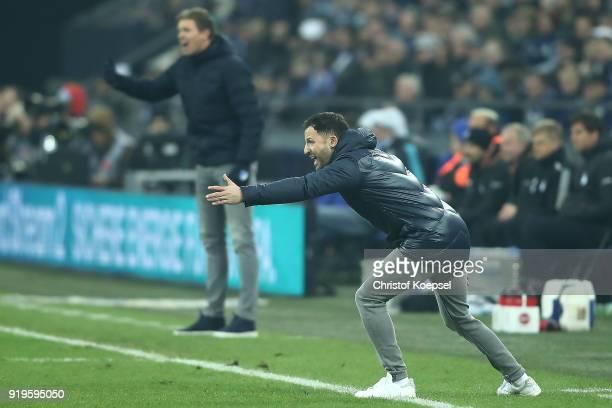 Coach Julian Nagelsmann of Hoffenheim and coach Domenico Tedesco of Schalke both gesture during the Bundesliga match between FC Schalke 04 and TSG...