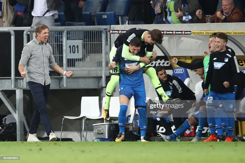 Coach Julian Nagelsmann of Hoffenheim (l) and players and staff from the bench celebrate after the Bundesliga match between TSG 1899 Hoffenheim and FC Bayern Muenchen at Wirsol Rhein-Neckar-Arena on September 9, 2017 in Sinsheim, Germany.