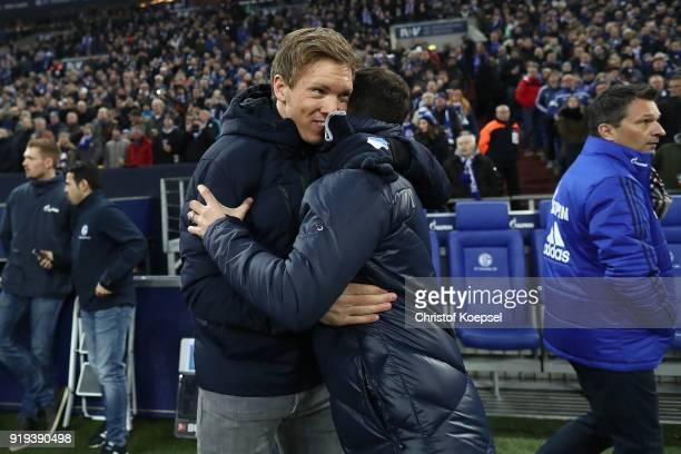 Coach Julian Nagelsmann of Hoffenheim greets Coach Domenico Tedesco of Schalke before the Bundesliga match between FC Schalke 04 and TSG 1899...