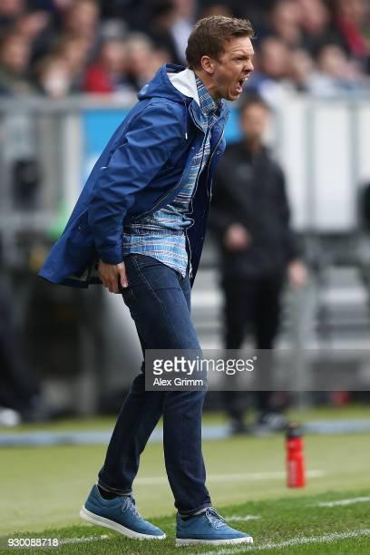 Coach Julian Nagelsmann of Hoffenheim screams during the Bundesliga match between TSG 1899 Hoffenheim and VfL Wolfsburg at Wirsol RheinNeckarArena on...