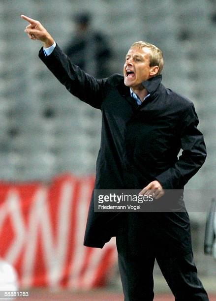 Coach Jurgen Klinsmann of Germany shouts instructions from the touchline during the friendly match between Turkey and Germany at the Ataturk Olympic...