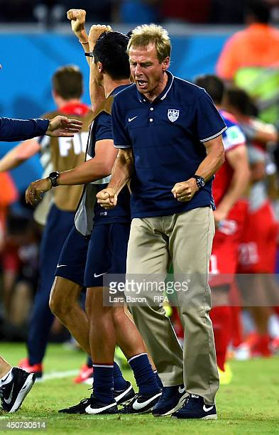 Coach Jurgen Klinsmann of the United States celebrates after John Brooks of the United States scores the team's second goal during the 2014 FIFA...