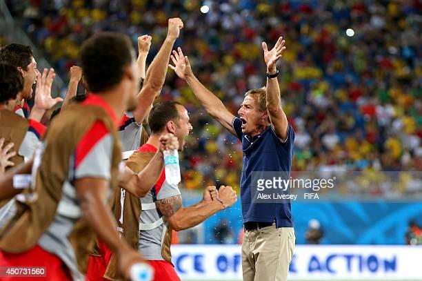 Coach Jurgen Klinsmann of the United States celebrates after the 2014 FIFA World Cup Brazil Group G match between Ghana and USA at Estadio das Dunas...