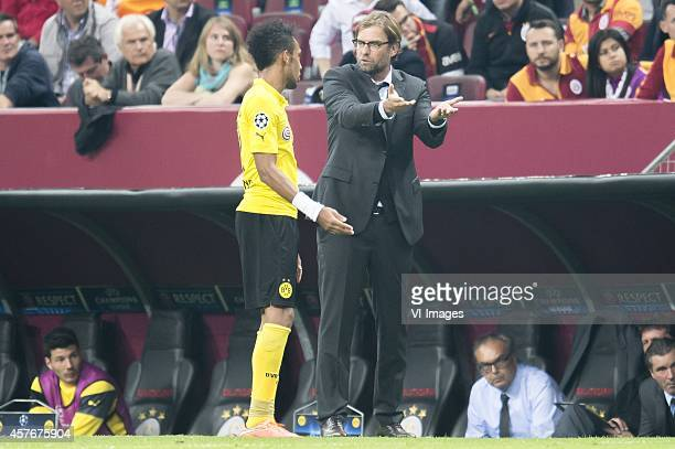 coach Jurgen Klopp of Borussia Dortmund give instructions to PierreEmerick Aubameyang of Borussia Dortmund during the UEFA Champions League group D...